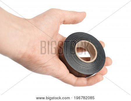 Hand holding black electrical tape on white background isolated