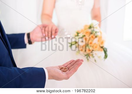 Groom Holding Wedding Rings On The Palm, The Groom In A Blue Suit, Groom Holding Wedding Rings, Groo