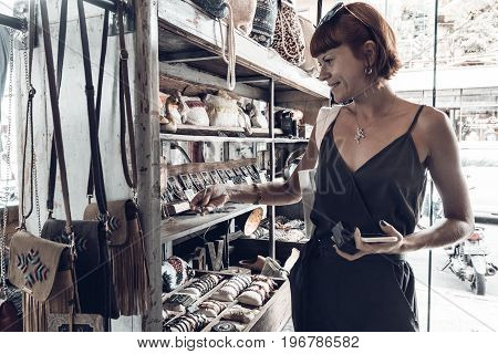 BALI, INDONESIA -JANUARY 1, 2017: Young woman in the souvenir shop, Ubud, Bali.