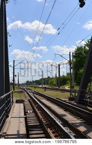 Summer Day Railway Landscape With A View From The Railway Bridge To The Suburban Passenger Station