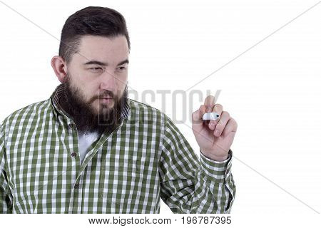 Man with a beard uses a green felt-tip pen on a white background