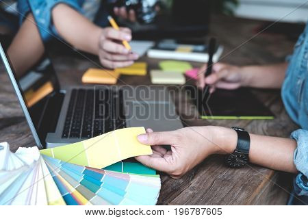 Young Photographer And Graphic Designer At Work In Studio Office.