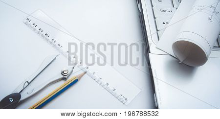 Architecture blueprint and tools on the desk