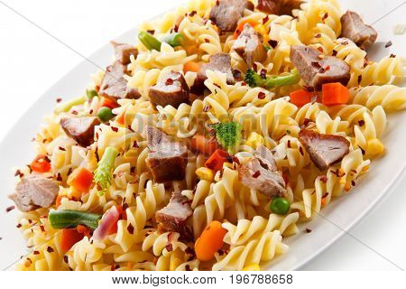 Pasta with beacon and colorful vegetables