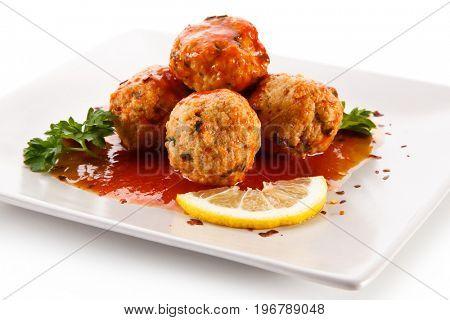 Roast meatballs with sauce