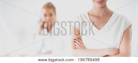 Attractive businesswoman with her arms crossed  standing in office