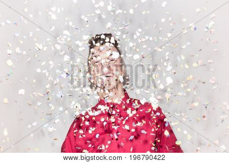 One Teenager Smiling, Looking To Camera, Red Shirt, White Background Studio, Confetti Party