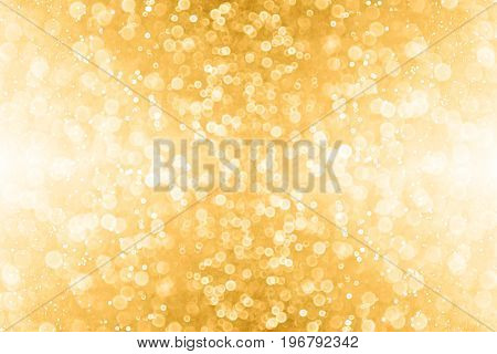 Abstract gold glitter sparkle confetti background or golden party invite for happy birthday, 50th anniversary banner, New Year's eve bash, Christmas blur, engagement or bridal texture