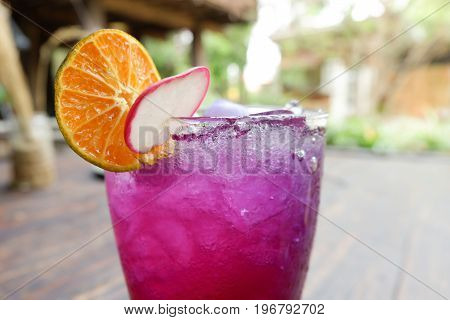 Close Up Water Mixed With Lemon Juice, Butterfly Pea Flowers