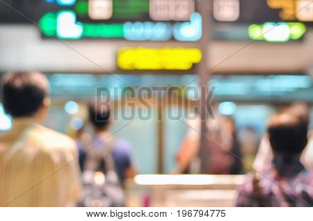 Blurred image of people waiting for arrival passengers at the airport terminal