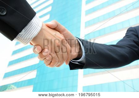 Handshake of businessmen - greeting dealing merger & acquisition concepts