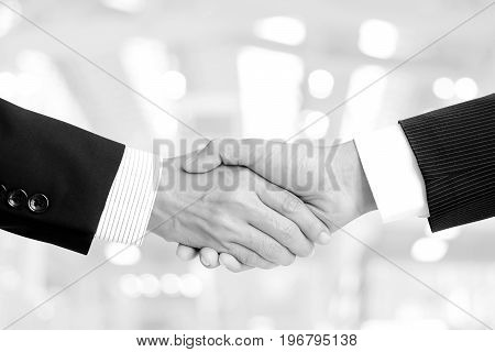 Handshake of businessmen in black and white (monochrome)