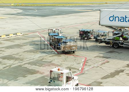 PRAGUE, CZECH REPUBLIC - JUNE 16, 2017: Vaclav Havel Prague International Airport, Ruzyne, Czech Republic. Passengers luggage loading in to the plane.