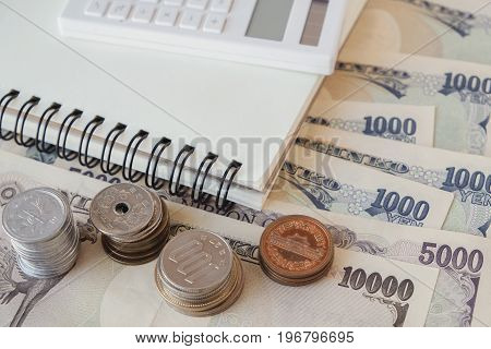 Japanese Yen money with calculator and notebook