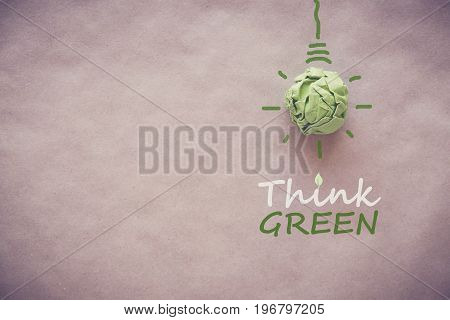 Green paper light bulb with Think Green eco energy saving concept