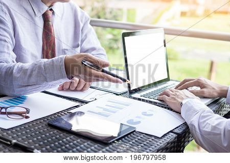 Business People Discuss Together About There Work By Graph Document And Setting In Outdoor For Plann