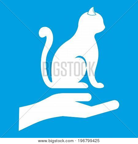 Hand holding a cat icon white isolated on blue background vector illustration