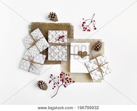 Handmade gift boxes on white background. Rustic style cute paper DIY decoration on sackcloth napkins. Valentine's day or other holiday concept. Flat lay top view