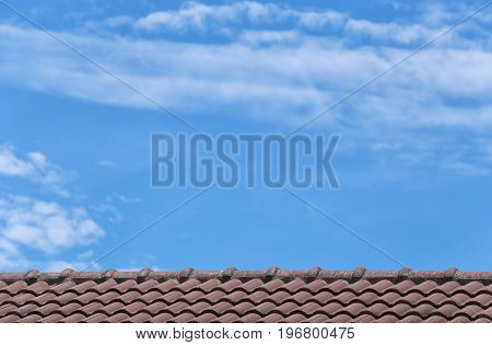 Roof tile of house and blue sky background.