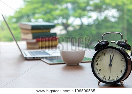 Retro Alarm Clock With Cup Of Cappuccino On Table In Office, Coffee Break Lunch Time