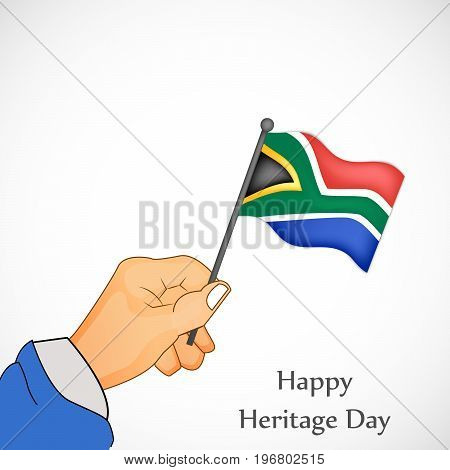 illustration of hand holding south Africa flag with Happy Heritage Day text on the occasion of Heritage Day