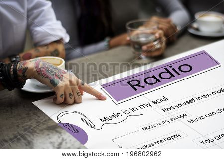 Hands working on billboard network graphic overlay on table