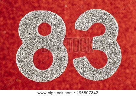 Number eighty-three silver color over a red background. Anniversary. Horizontal