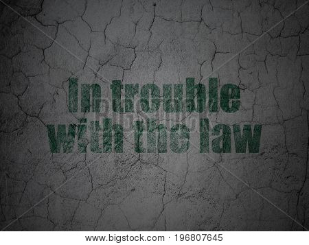 Law concept: Green In trouble With The law on grunge textured concrete wall background
