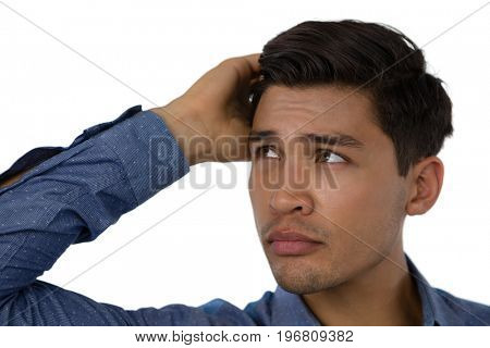 Close up of confused businessman against white background