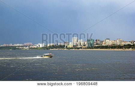 Samara city and Volga river, boat, Russia