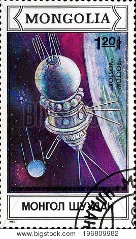 UKRAINE - CIRCA 2017: A postage stamp printed in Mongolia shows spaceship Vostok from series Space research circa 1988
