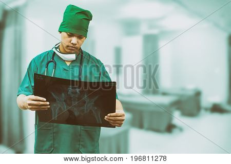 Surgical doctor examining xray film diagnose patient 's waist bone. Surgery operation concept.