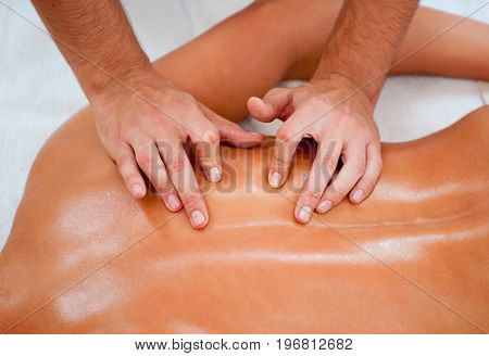 Massaging Back Muscles, Top View, Color Image, Horizontal Image