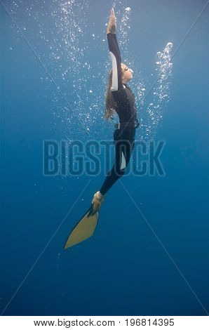 Free diver underwater shoot color image, side view