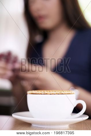 Stroopwaffle On Hot Coffee Cup And Blur Woman