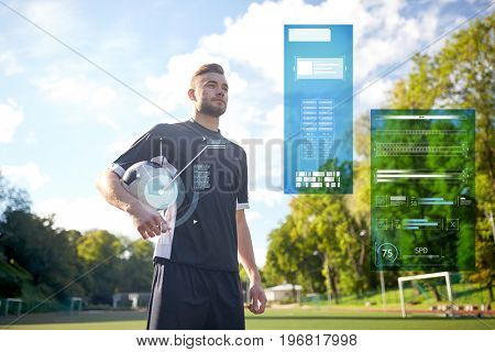 sport, technology and people concept - soccer player with ball on football field