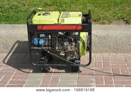 Diesel Portable Generator. Close up on Mobile Diesel Backup Generator. Diesel Standby Generator - Outdoor Power Equipment.