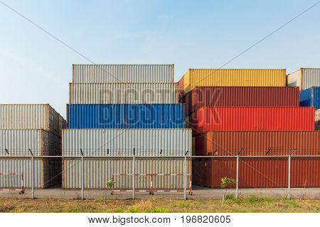 Handling container stack in shipping yard, Business industry.