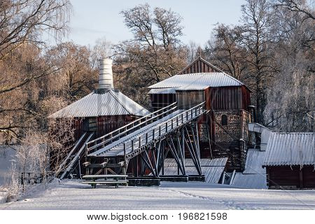 World heritage Ironworks in Sweden more then a hundred years old blast furnace on a freezing winter day.