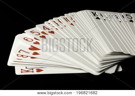 Cards Spread Out on a black background.