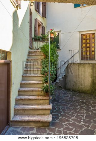 Entrance of an old apartment building in Malcesine, Italy.