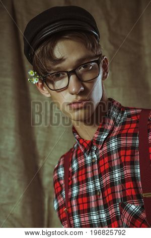 Stylish guy in a plaid shirt and wildflowers