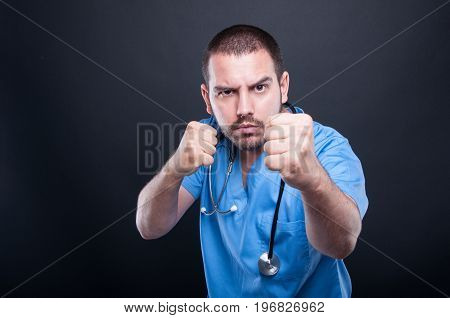 Mad Doctor Wearing Scrubs With Stethoscope Fighting