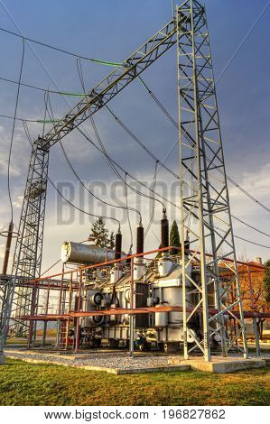 Power transformer in high voltage switchyard in modern electrical substation