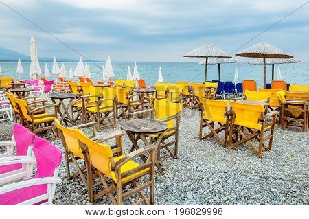Tables and chairs on a beach in Platamonas. Pieria Macedonia Greece Europe