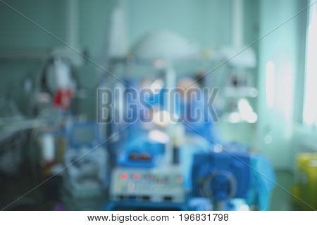 Unfocused hospital unit with the working personnel.