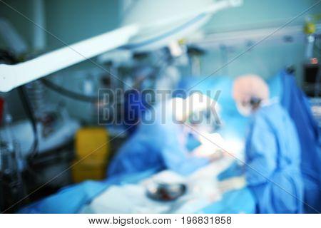 Medical work in the ICU unfocused background.