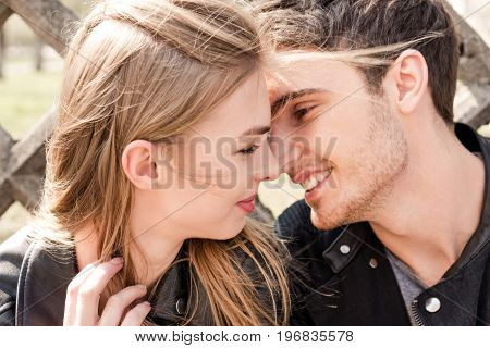 Portrait Of Smiling Young Man Kissing Attractive Girlfriend