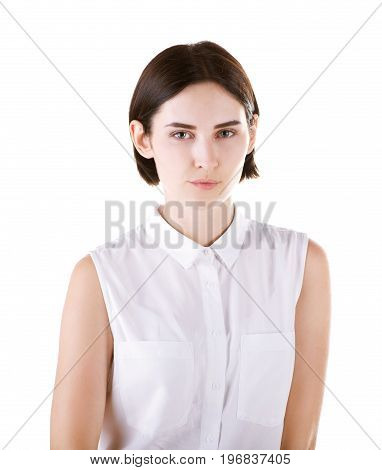 A charming and expressive brunette woman isolated over the white background. A natural and professional young lady in casual clothes. A sarcastic and playful adorable female.
