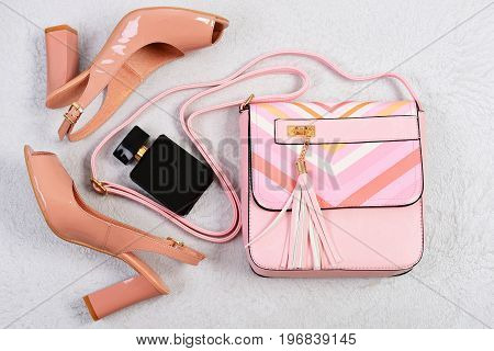 High Heel Women's Shoes And Accessories On White Background.